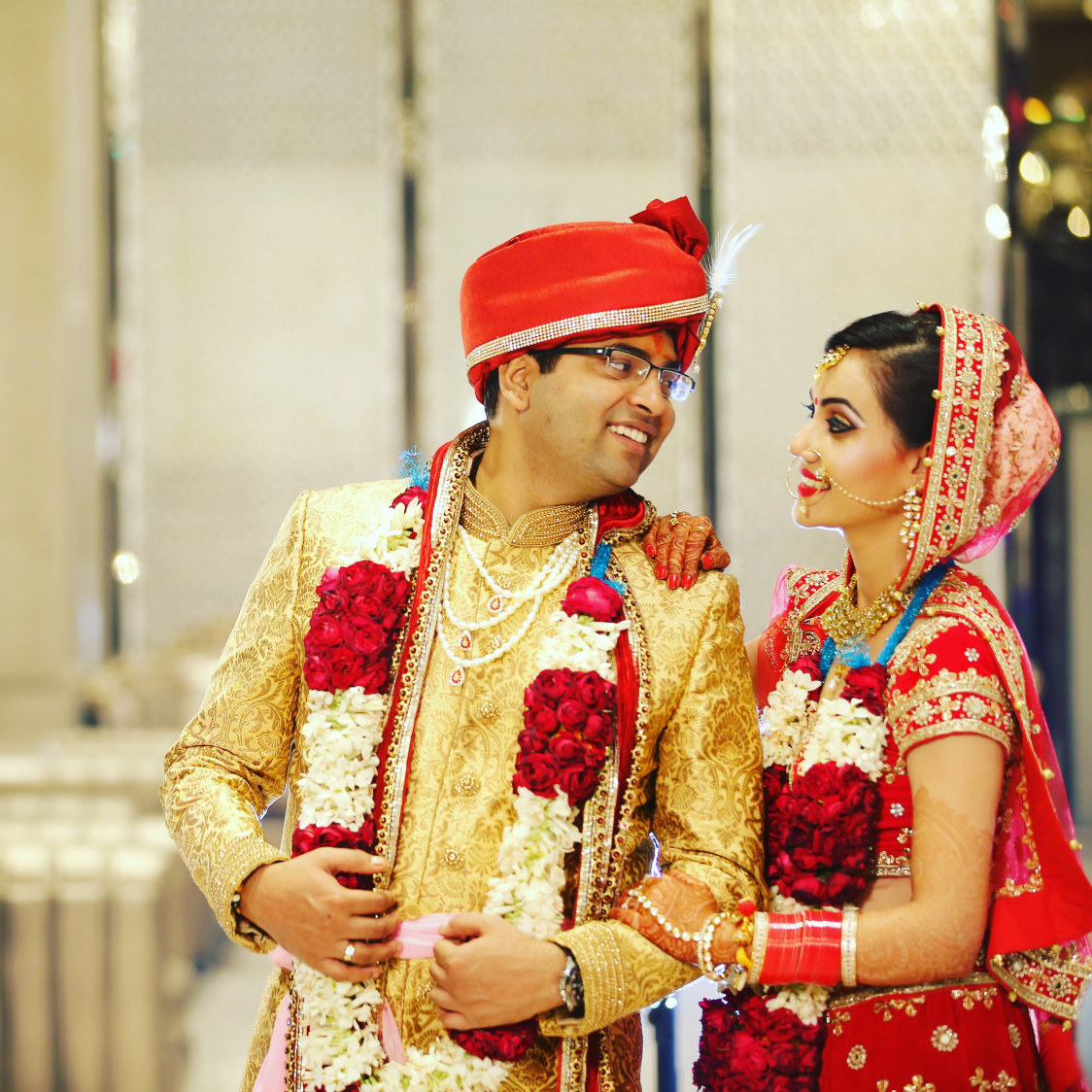 Handsome Groom In Golden Sherwani And Red Silk Turban With Golden Intricate Embroidery by Preeti Sharma Wedding-photography Bridal-jewellery-and-accessories Groom-wear-and-accessories | Weddings Photos & Ideas