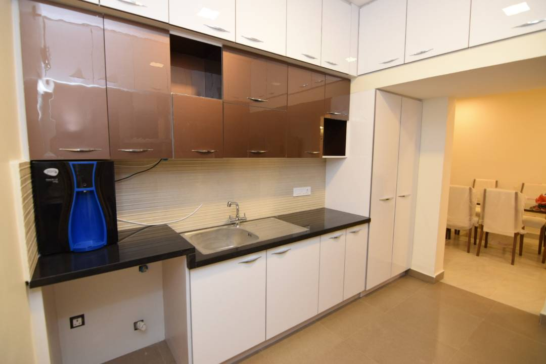 Modular Kitchen With Glossy Cabinets And Black Counter Top By Designers5 Interiors Bangalore