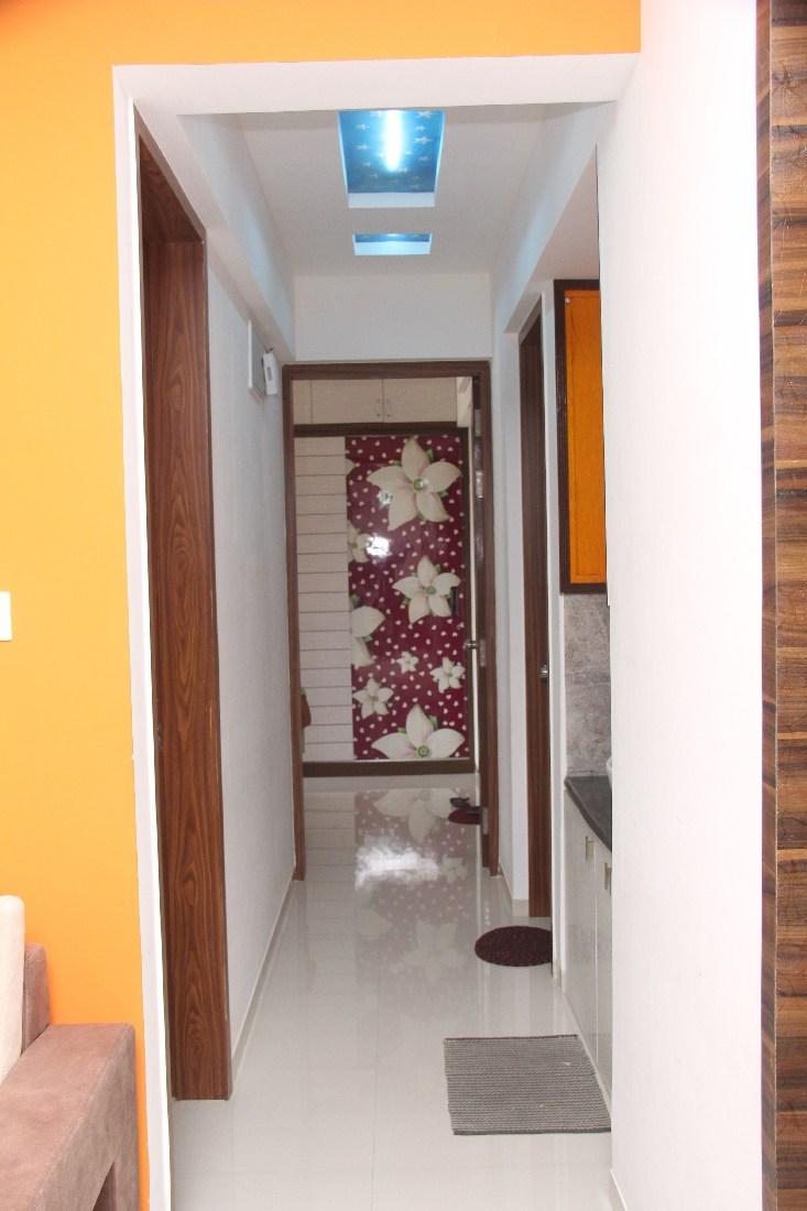 Yellow Wall In Modern Hallway by Star Design Indoor-spaces Modern | Interior Design Photos & Ideas