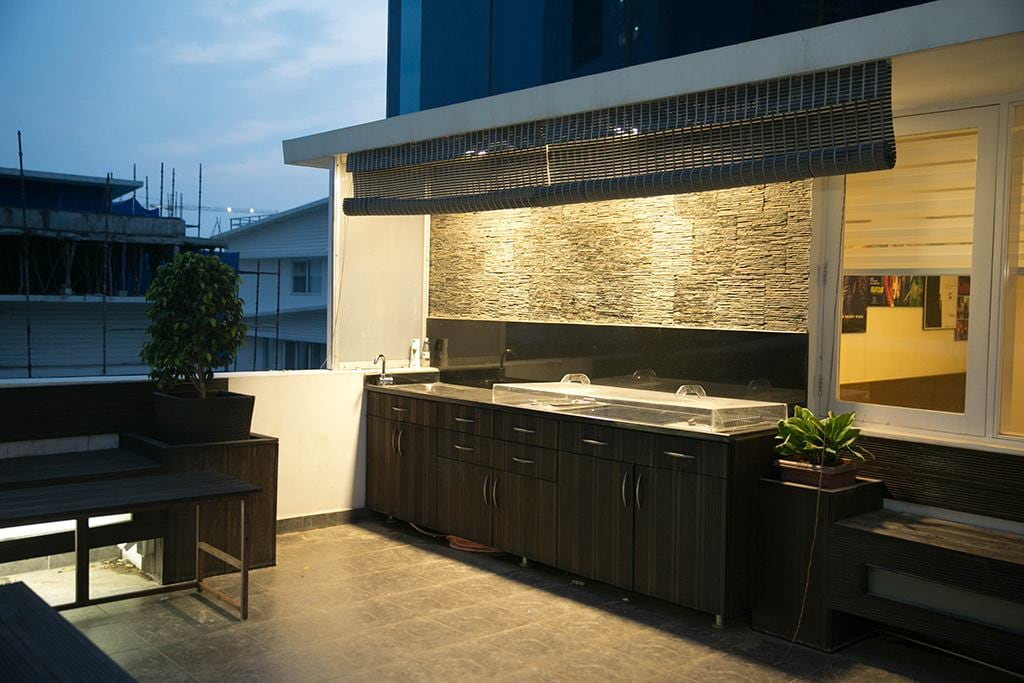 Balcony With Wooden Flooring And Dark Brown Cabinets by Kv Patel Open-spaces Contemporary | Interior Design Photos & Ideas