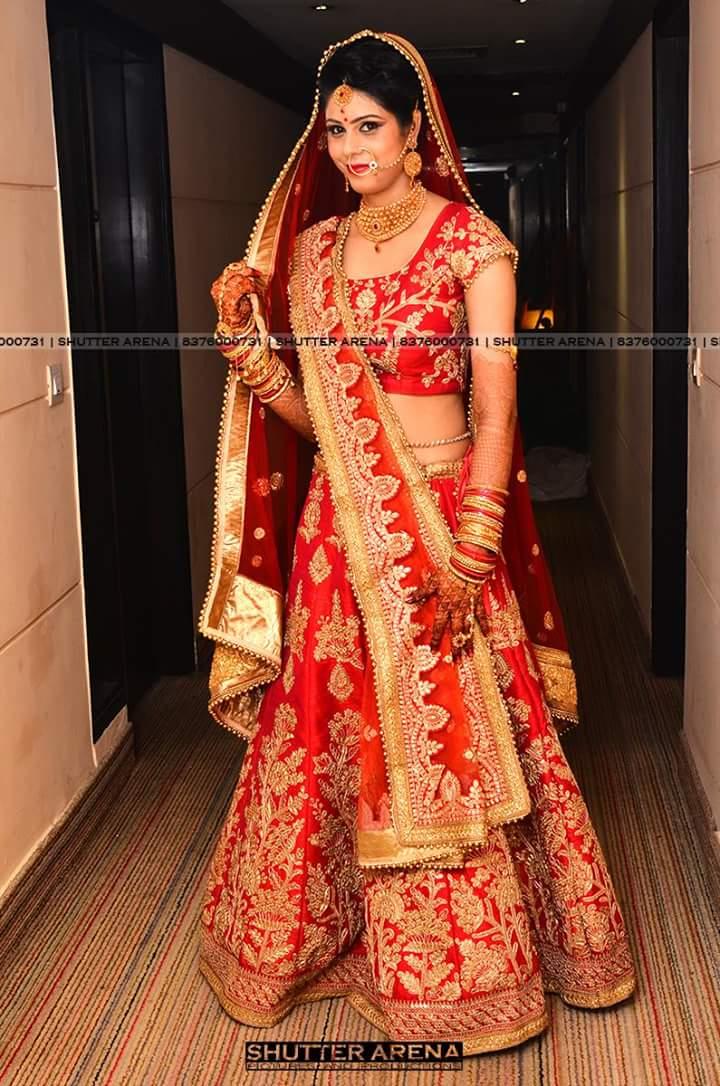 The flamboyant attire by SHUTTER ARENA Wedding-photography | Weddings Photos & Ideas