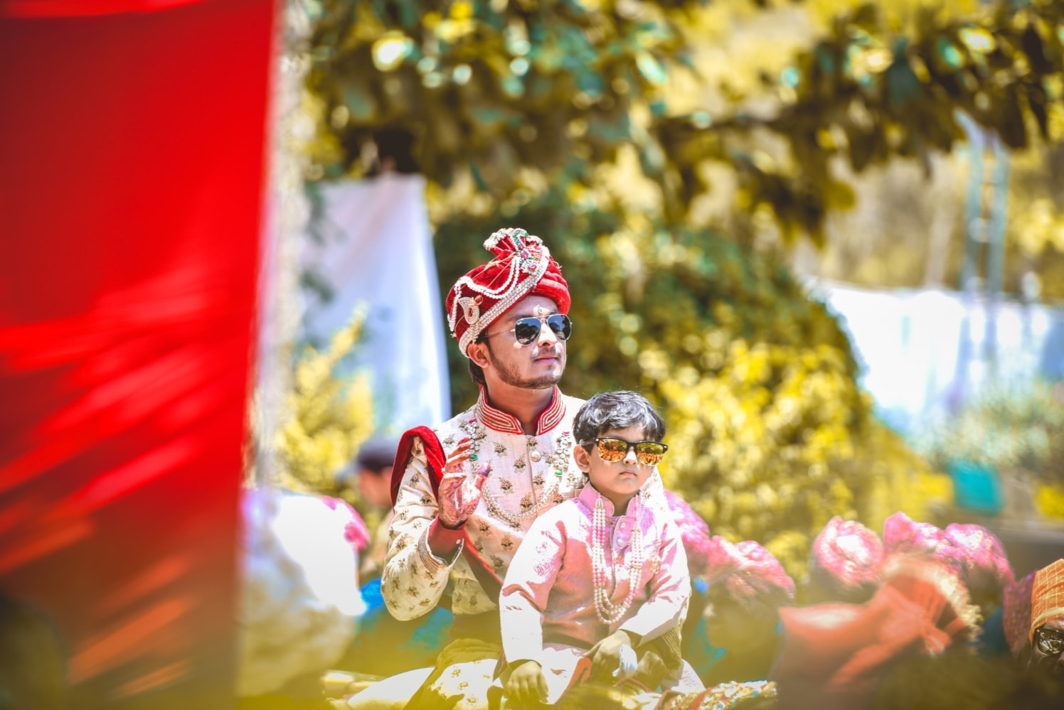Handsome Groom In Golden Sherwani And Red Silk Turban With Golden Intricate Embroidery by Aniket Kanitkar Wedding-photography Groom-wear-and-accessories | Weddings Photos & Ideas