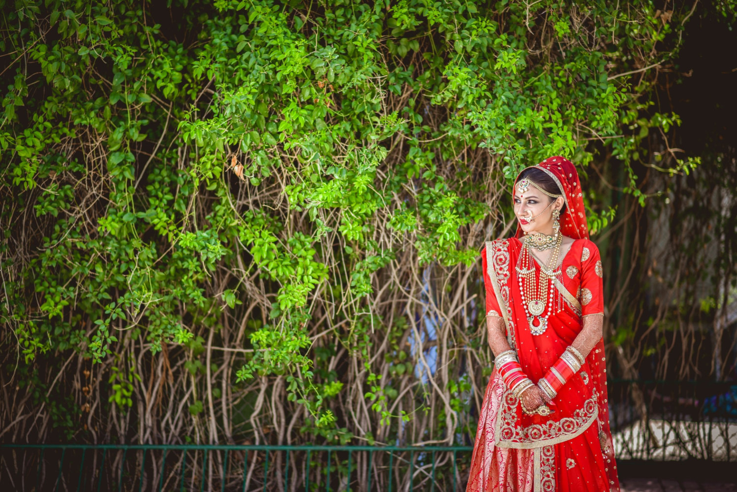 Bride Wearing Red Lehenga With Golden Embroidery by Aniket Kanitkar Wedding-photography Wedding-dresses | Weddings Photos & Ideas