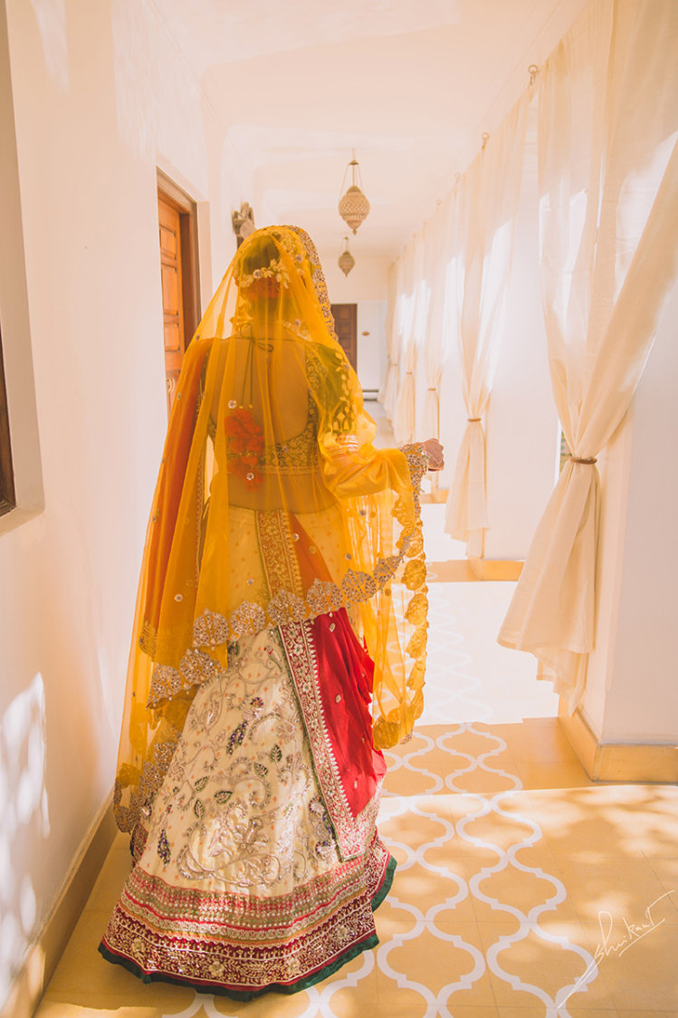 Back shot in amber attire by Shrikant Narayan Arora Wedding-photography | Weddings Photos & Ideas