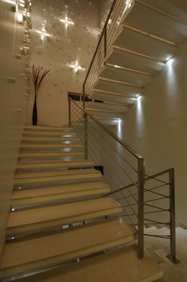 L Shaped Staircase With Cream Shade by Jyoti Yadav Indoor-spaces Modern | Interior Design Photos & Ideas