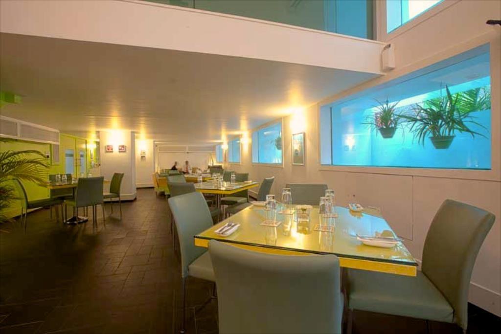 Trendy White Themed Restaurant Decor by Viraf Laskari  Modern   Interior Design Photos & Ideas
