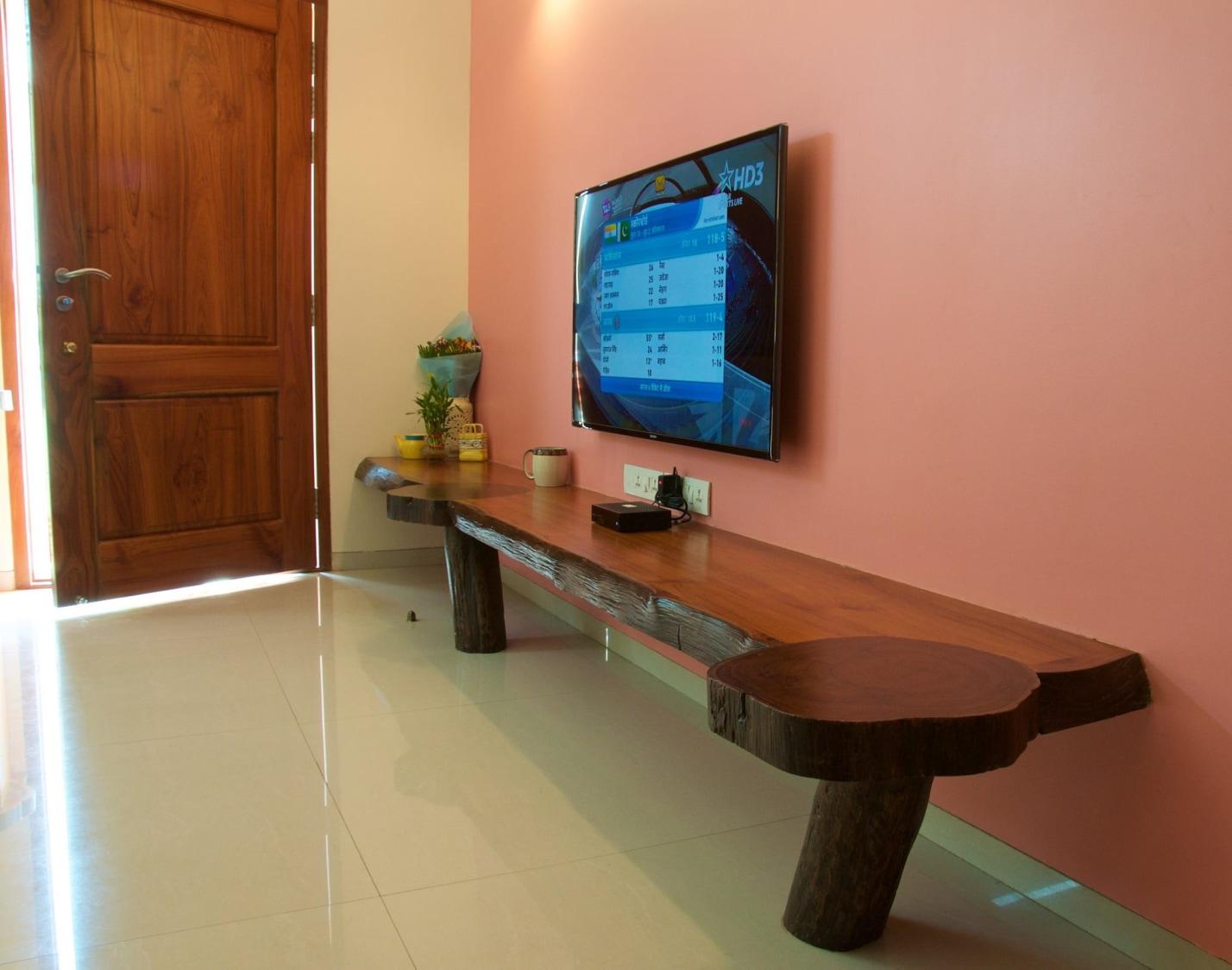 TV unit with Pink Wall and Wooden Display Unit by Viraf Laskari  Living-room Minimalistic | Interior Design Photos & Ideas