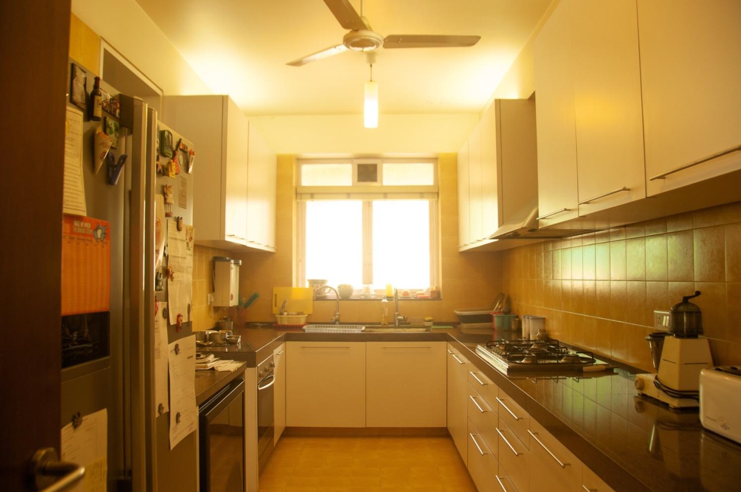 U Shaped Modular Kitchen with White Glossy Cabinets and Black Counter Top by Viraf Laskari  Modular-kitchen Modern | Interior Design Photos & Ideas