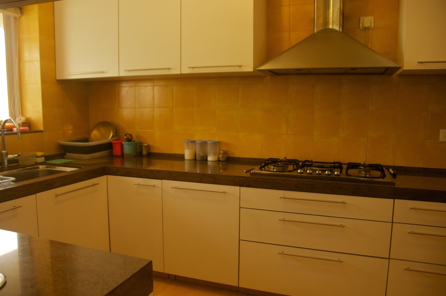 Modular Kitchen With White Glossy Cabinets and Black Counter Top by Viraf Laskari  Modular-kitchen Modern | Interior Design Photos & Ideas