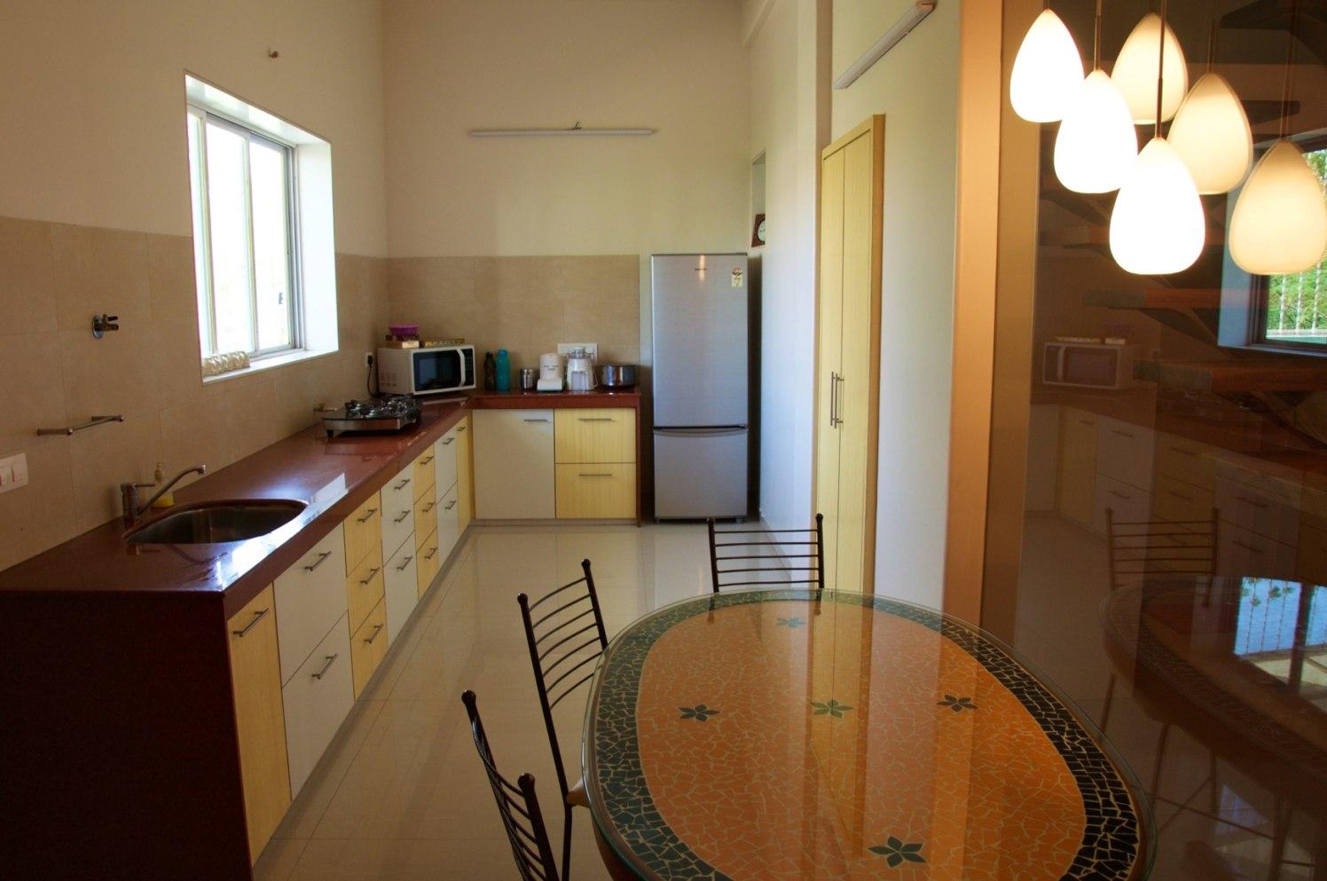 L Shaped Modular Kitchen With Mosaic Art Dining Table by Viraf Laskari  Modular-kitchen Modern | Interior Design Photos & Ideas
