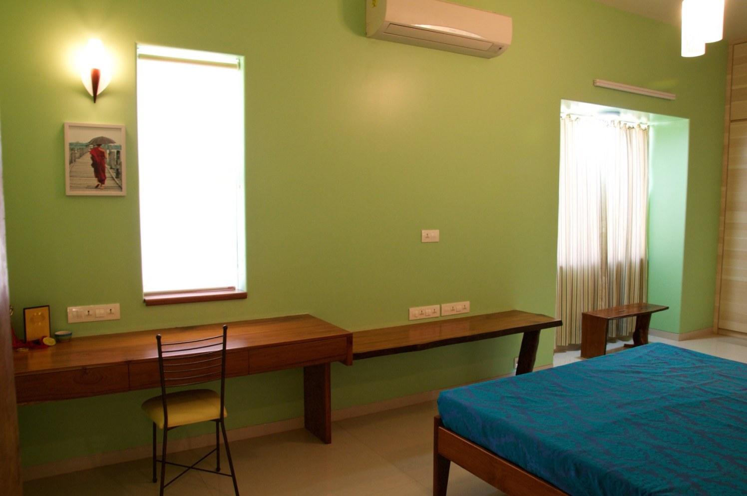 Simple Study Space In Guest Bedroom With Green Wall by Viraf Laskari  Bedroom Contemporary | Interior Design Photos & Ideas