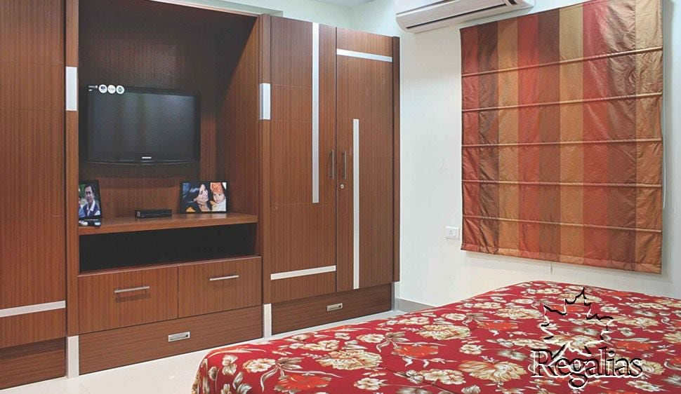 Wooden Finish wardrobe with Entertainment Unit by Regalias Interiors Bedroom Traditional | Interior Design Photos & Ideas