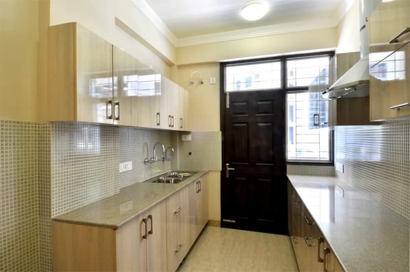 parallel modular kitchen with beige shaderegalias