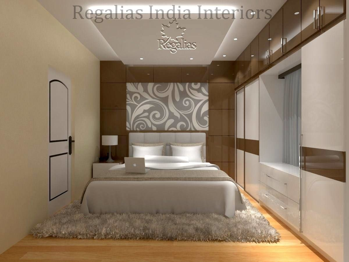 Wooden Flooring And Beige Shade Interiors In Bedroom by Regalias Interiors Bedroom Contemporary | Interior Design Photos & Ideas