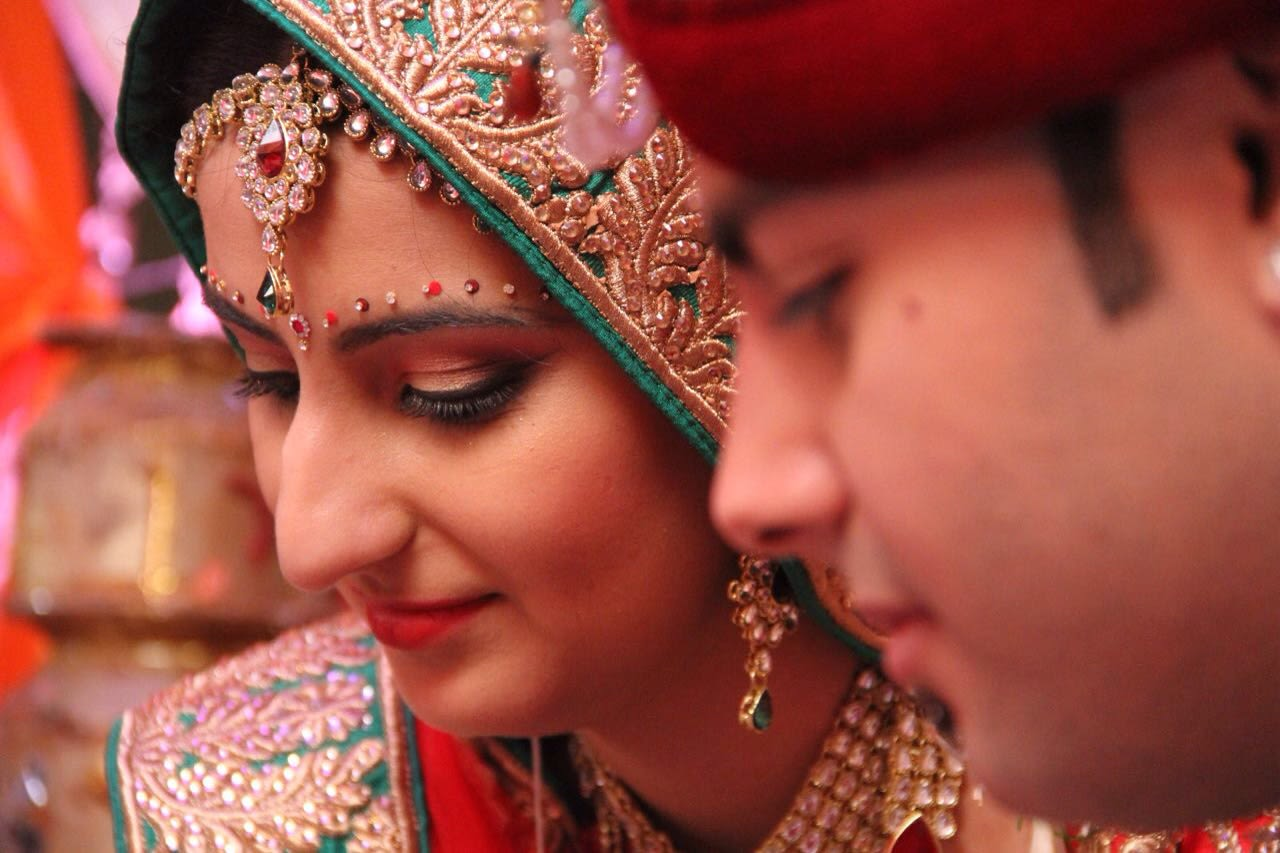 Crimson shades of bridal outfit and bridal makeup by Heena Video Wedding-photography Bridal-makeup | Weddings Photos & Ideas