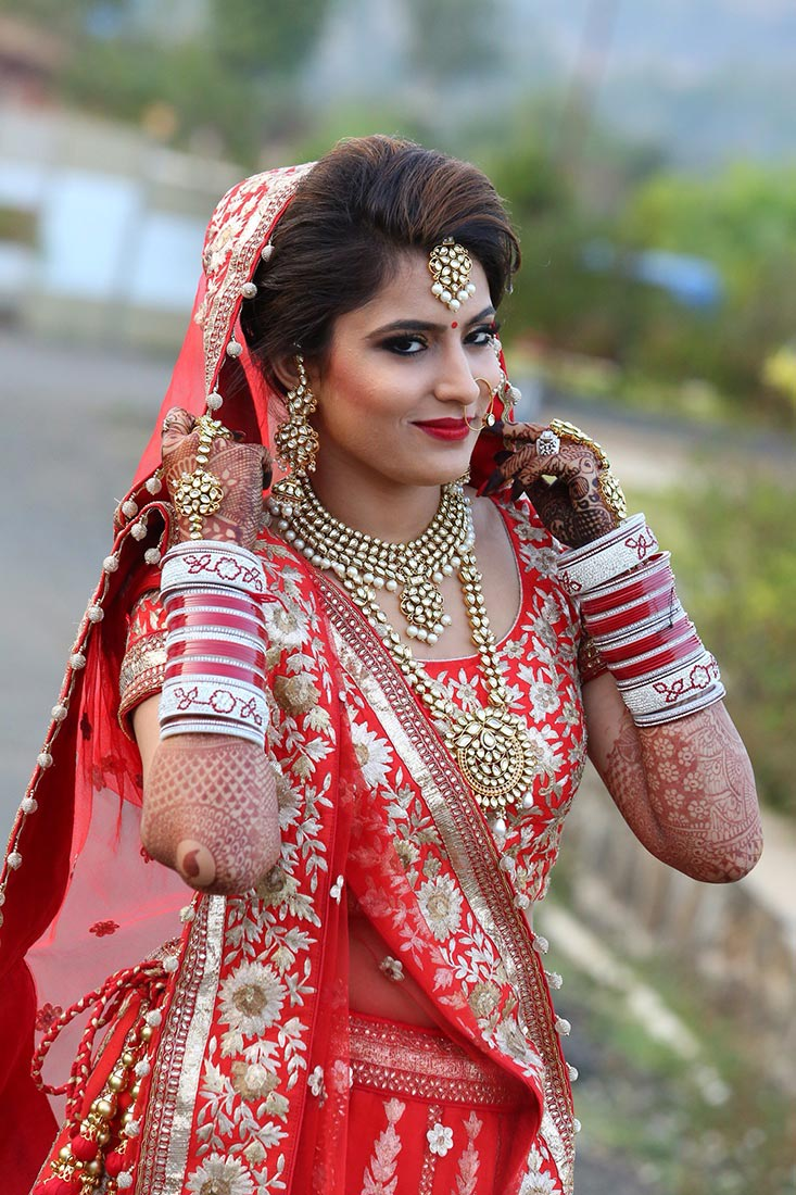 Crimson shades of the bridal outfit with kundan accessories! by Heena Video Wedding-photography | Weddings Photos & Ideas