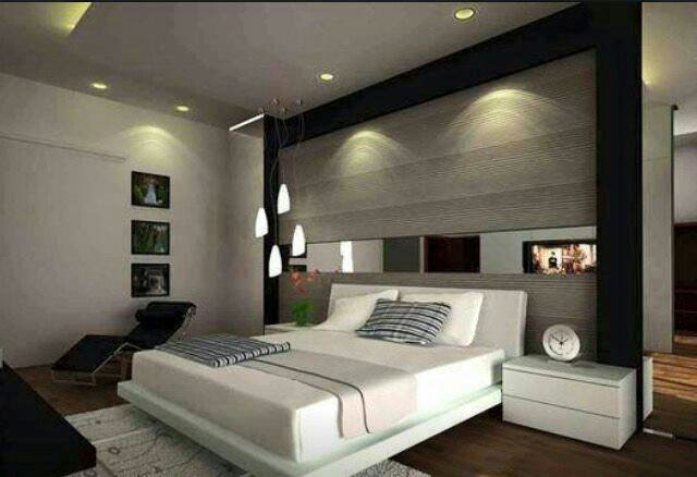 Low Lying Bedroom With Smooth Wooden Wall Surface by HOC Designarch Bedroom Contemporary | Interior Design Photos & Ideas