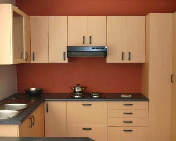 Sleek Wooden Kitchen Cabinets by Swastik Interiors Modular-kitchen Minimalistic | Interior Design Photos & Ideas