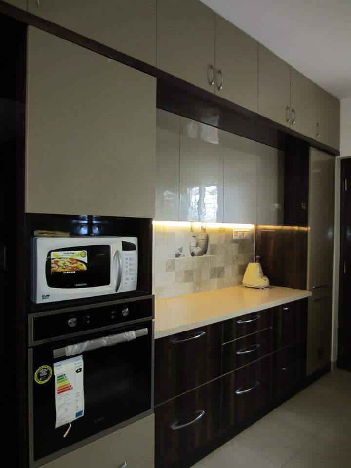 elegant kitchen by Richa Jatale Modern | Interior Design Photos & Ideas
