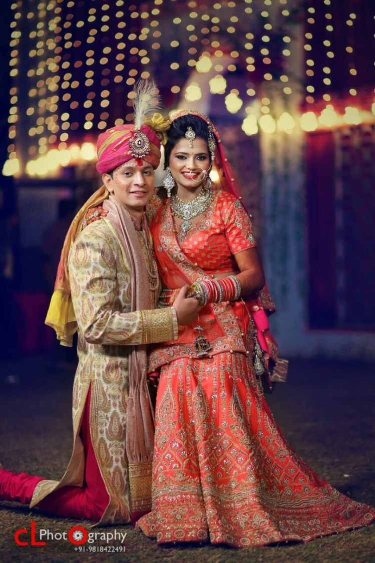 Orange Bridal Lehenga With Silver Detailing And Golden Sherwani  With Maroon Chudidaar And  Pink And Yellow Turban Completing Its Look With A Kilangi Brooch by CL Photography Wedding-photography Groom-wear-and-accessories Wedding-dresses | Weddings Photos & Ideas