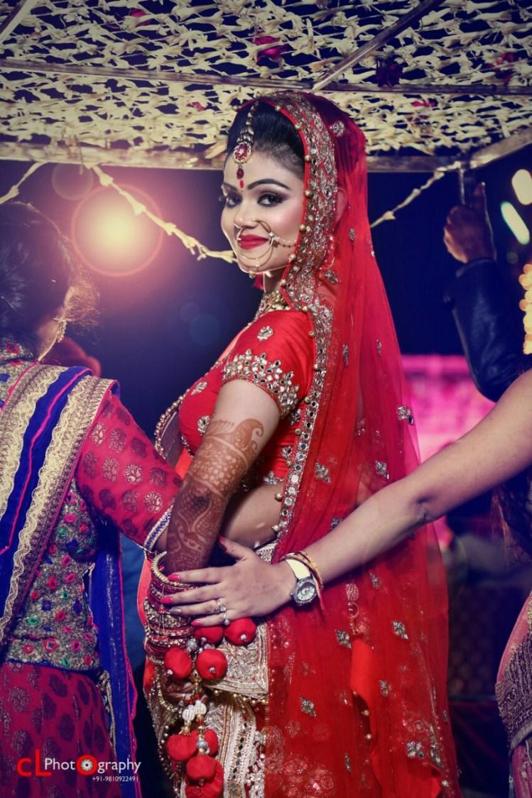 Crimson Bridal Gaze Under Phool Chadar by CL Photography Wedding-photography   Weddings Photos & Ideas