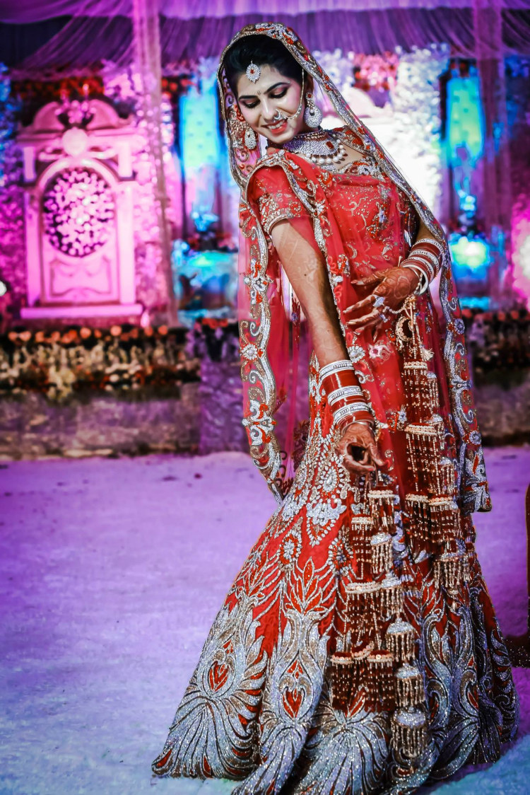 Bride In Red Heavily Embellished Lehenga by Gitesh Dhawan Wedding-photography Wedding-dresses | Weddings Photos & Ideas