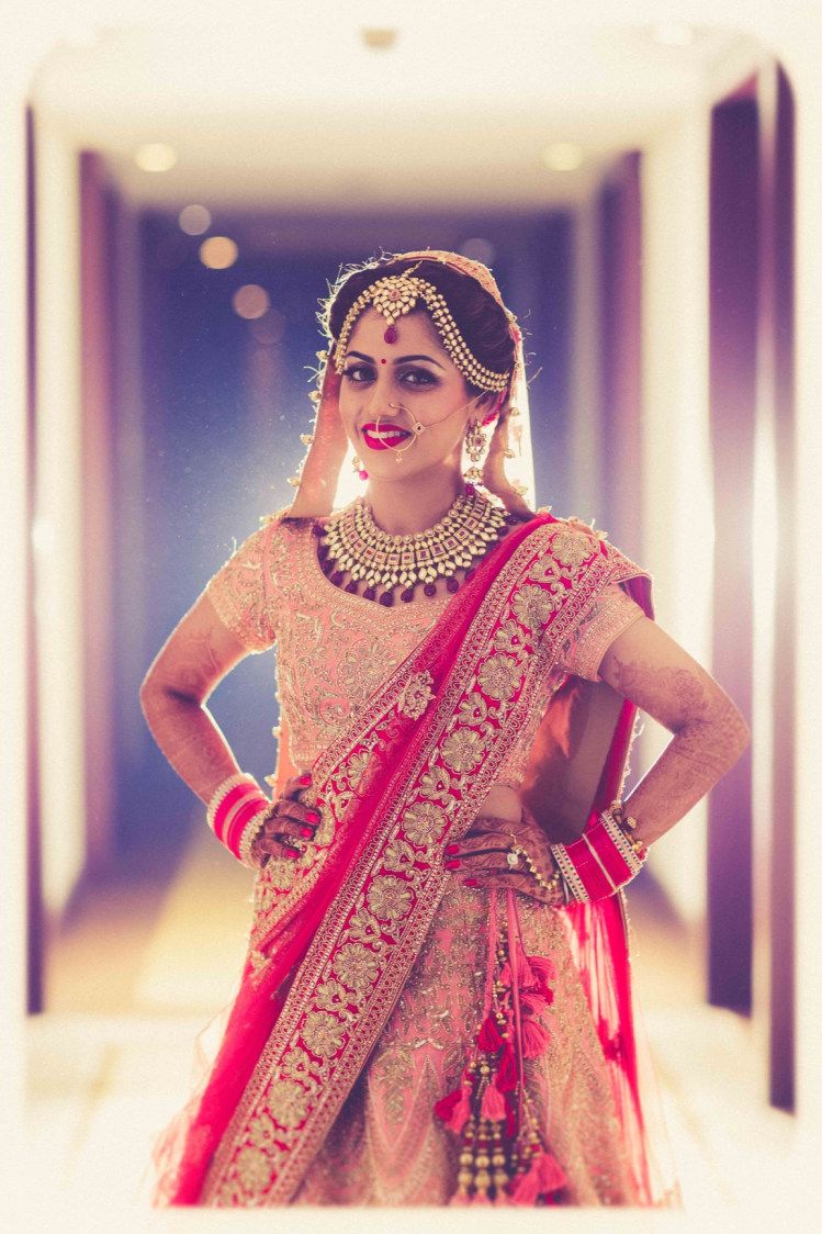 Bride Wearing Red And Peach Lehenga With Golden Embroidery by Gitesh Dhawan Wedding-photography | Weddings Photos & Ideas