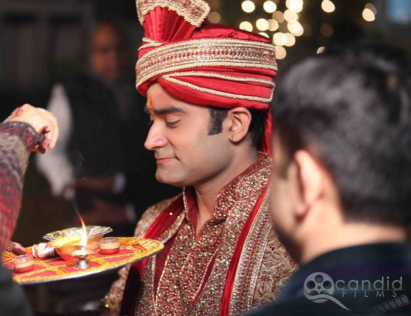 Groom's welcome by Candid Films Wedding-photography Groom-wear-and-accessories | Weddings Photos & Ideas