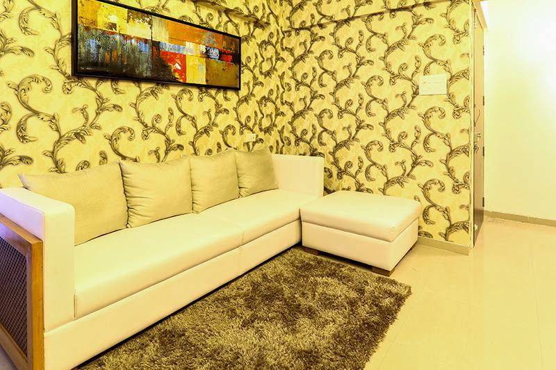 White Sectional Sofa And Wall With Golden Intricate Work by Wood Works Club Living-room Contemporary | Interior Design Photos & Ideas