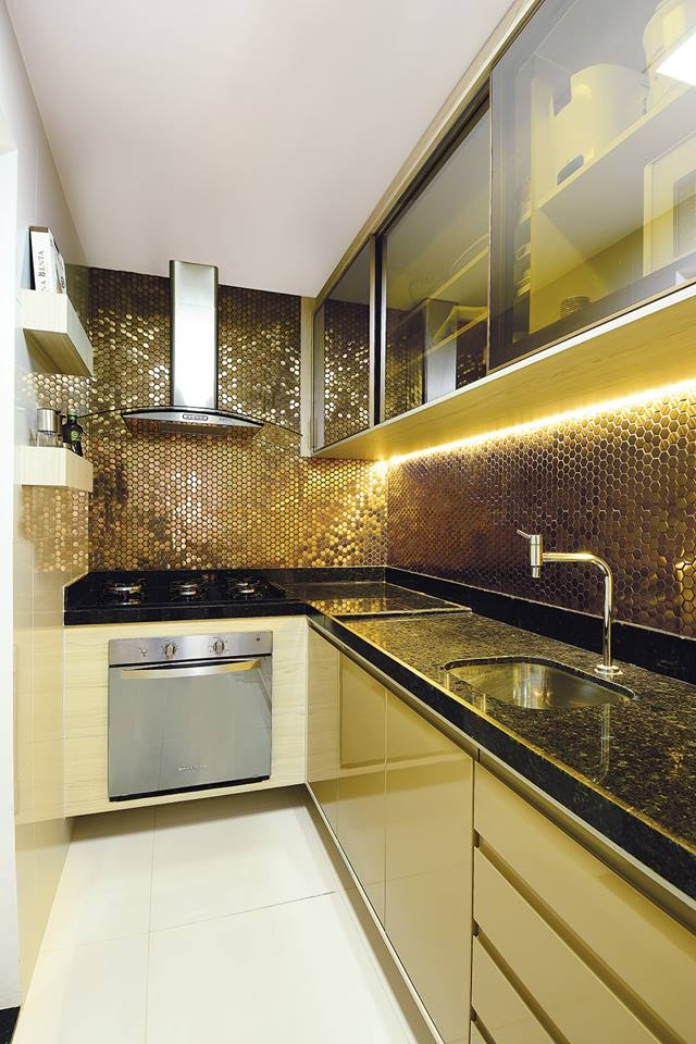 L-Shaped Modular Kitchen With Golden Shades by Icraft Desginz and interiors Modular-kitchen Modern | Interior Design Photos & Ideas