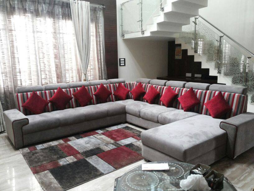 Grey Colored Sectional Sofa With Red Cushions For Living Space by Icraft Desginz and interiors Living-room Modern | Interior Design Photos & Ideas