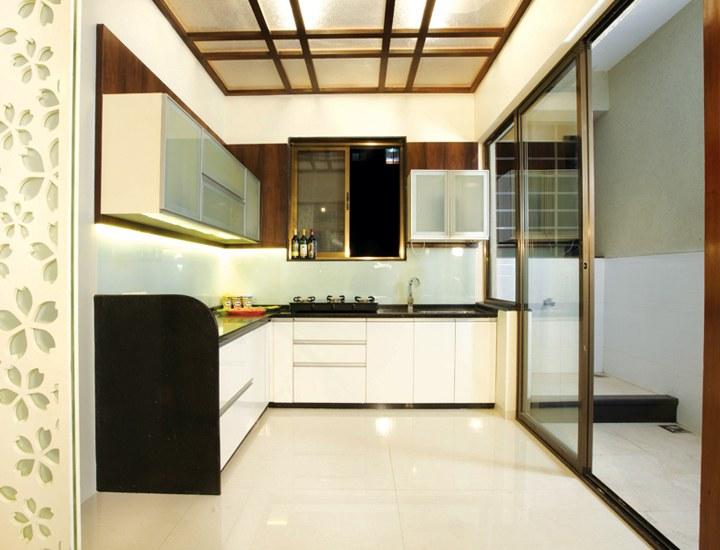 White Themed Modular Kitchen With Wooden Work by VJP. DECORS  Modular-kitchen Contemporary | Interior Design Photos & Ideas
