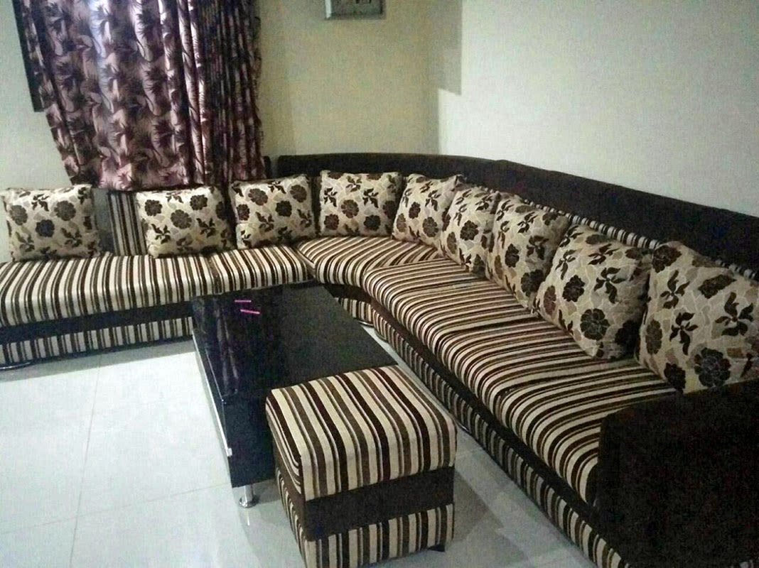 Living Room With Striped Sofa And Floral Print Cusions by Madhumathi. J. Dharwar Living-room Contemporary | Interior Design Photos & Ideas