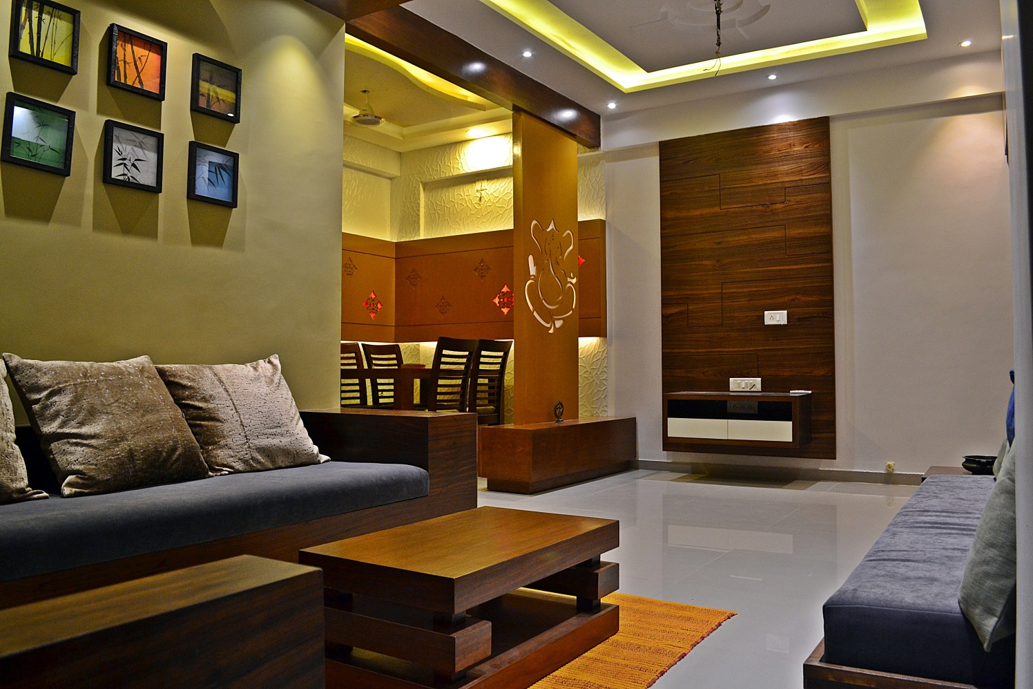 Living Area With Dark Grey Sofa And Brown Cusions by Ankita Patel Living-room Modern | Interior Design Photos & Ideas
