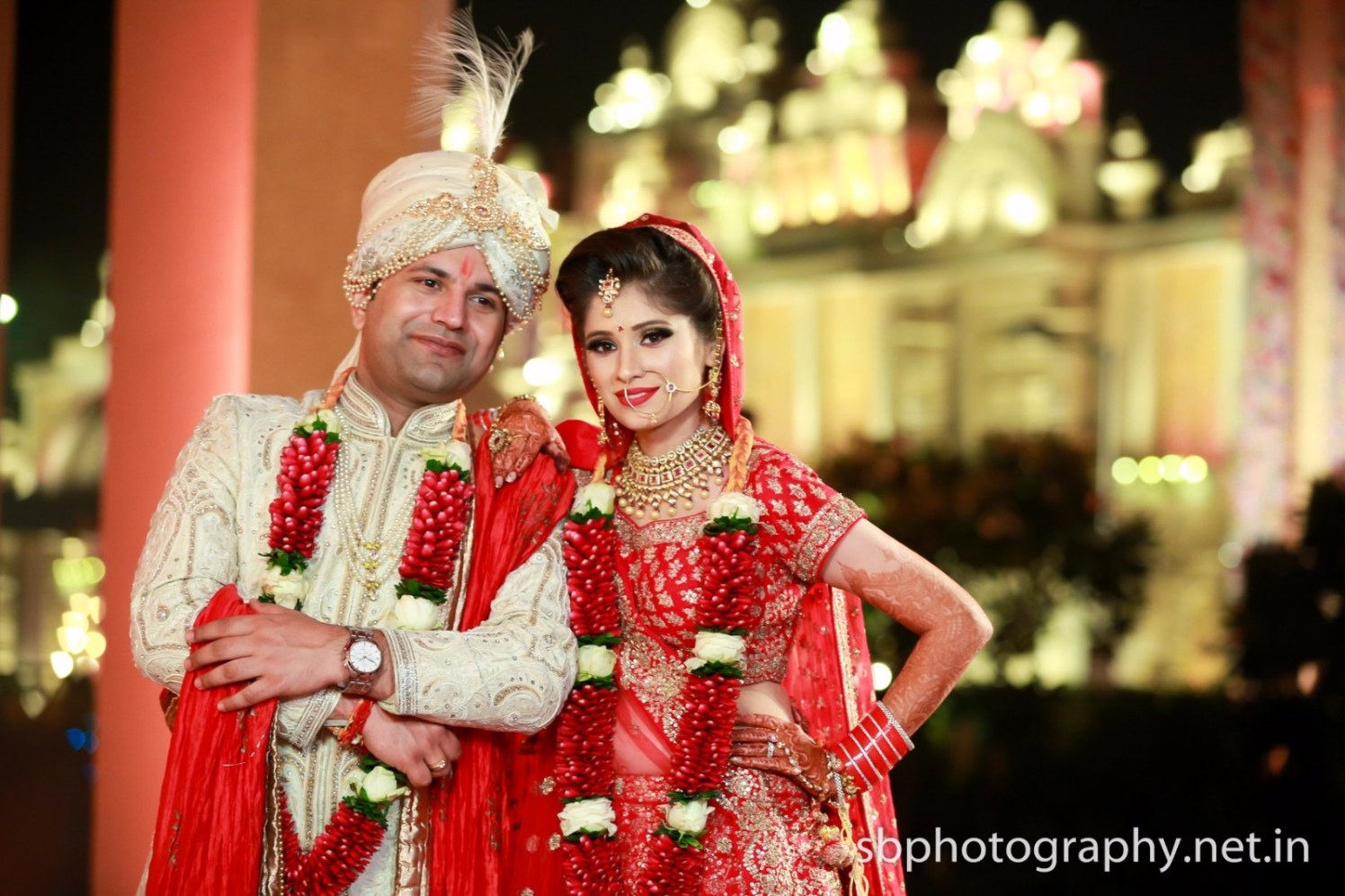 Bride and Groom Wearing Red Themed Traditional Wear by Sanjay Balyan Wedding-photography Groom-wear-and-accessories | Weddings Photos & Ideas