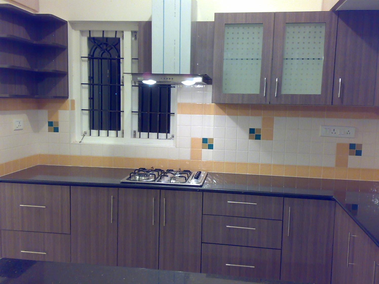 Brown Wooden Cabinets by Dhanu Nayak Modular-kitchen Contemporary | Interior Design Photos & Ideas