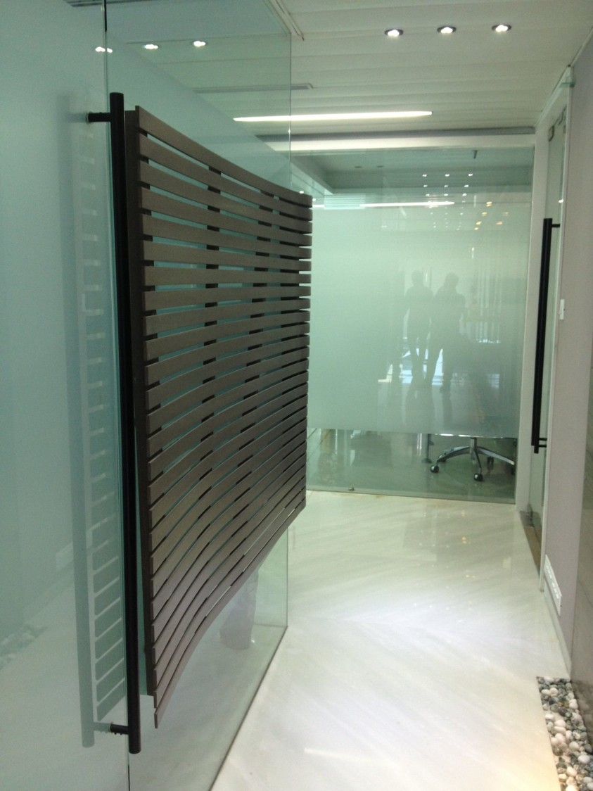 Entrance to a well lit office by Izan Architecture & Interiors Modern | Interior Design Photos & Ideas