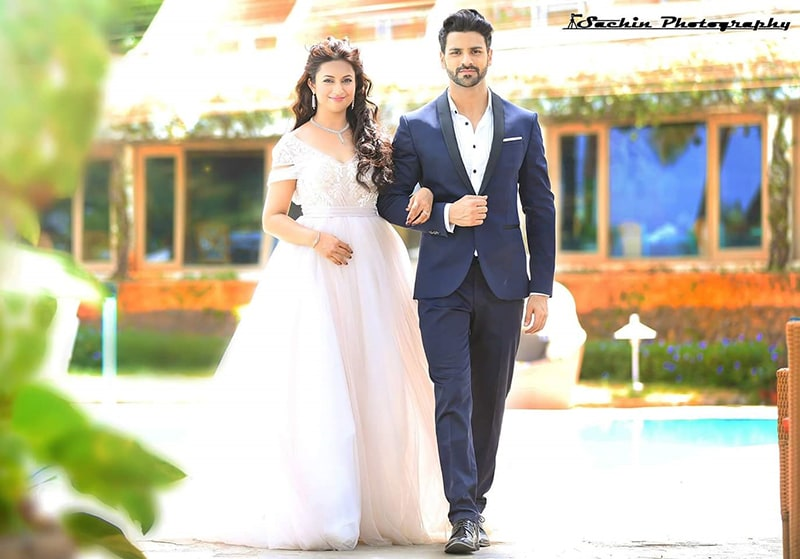 Alluring White Flare Ball Gown And Navy Blue Suit For Pre-Wedding Shoot by Sachin Kumar Wedding-photography Groom-wear-and-accessories Wedding-dresses | Weddings Photos & Ideas
