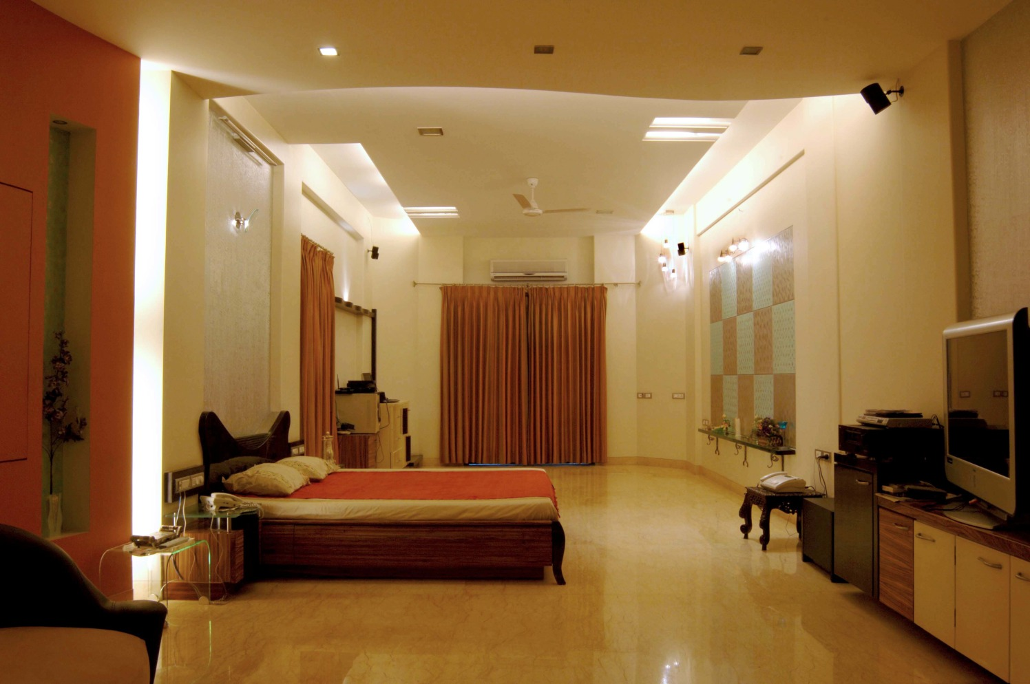 Beige bedroom with king sized bed and false ceiling by S.K.Interiors Bedroom Contemporary | Interior Design Photos & Ideas
