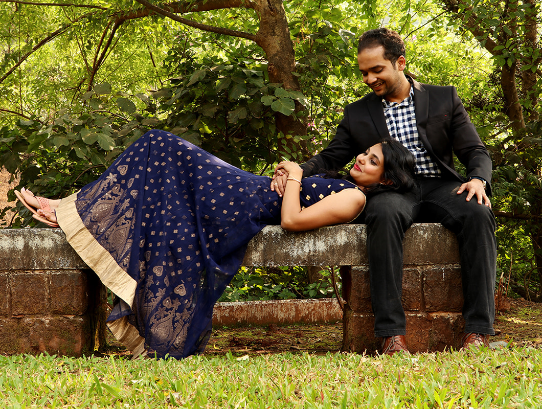 Bride and Groom To-Be Pose Against a Picturesque Garden Backdrop by Rushil Jadhav Wedding-photography Groom-wear-and-accessories Wedding-dresses | Weddings Photos & Ideas