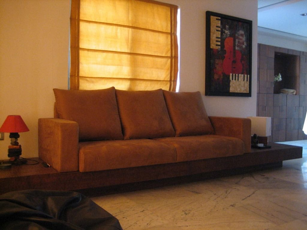 Living space with brown sofa and cushions by Chaitanya Deshmukh Living-room | Interior Design Photos & Ideas