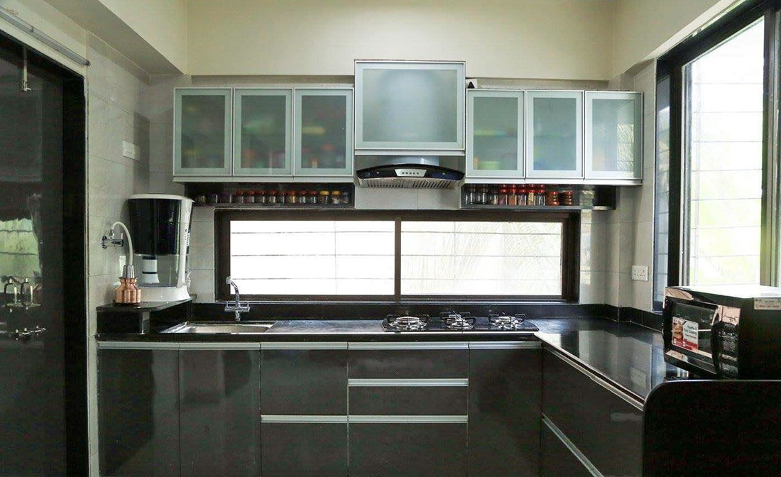 L shaped kitchen with cabinets by Chaitanya Deshmukh