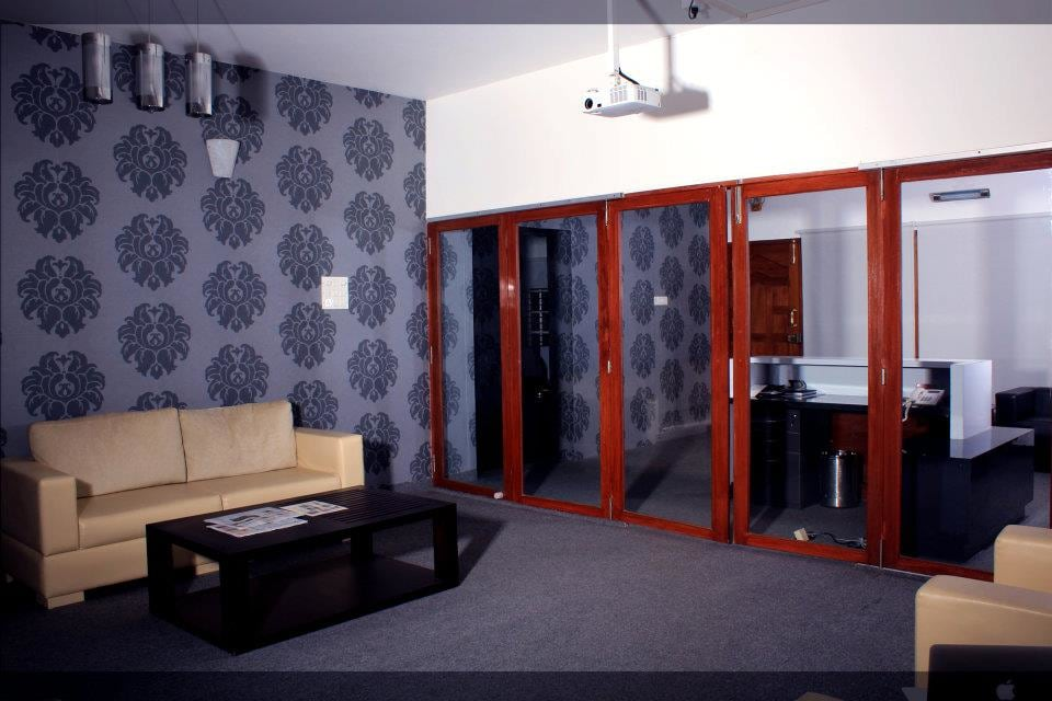 Waiting Area With Patterned Wall by D'insignia
