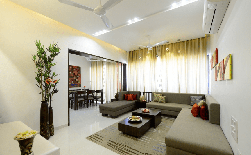 White themed Living Room with L shaped Sofa and White Glossy Flooring by Shristi Interiors Living-room Modern | Interior Design Photos & Ideas