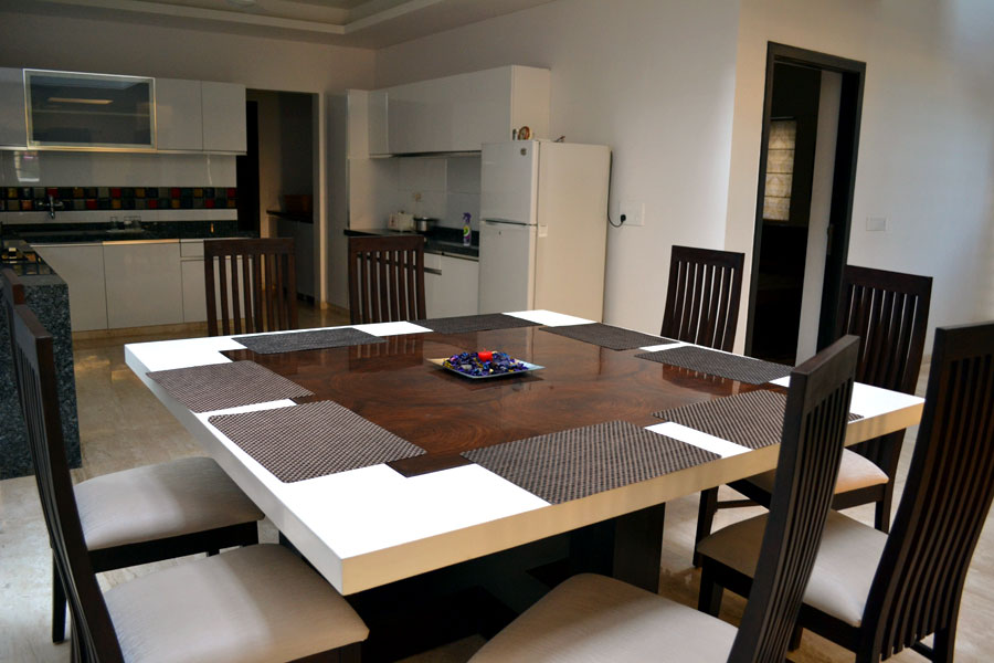 Well Kept Dining Room with Square Patterned Table and Wooden Chairs by Shristi Interiors Dining-room Modern | Interior Design Photos & Ideas