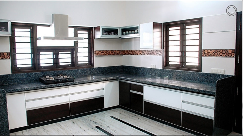 Modular Kitchen With L Shaped Counter And Tropical Green Granite Counter Top By Shristi Interiors