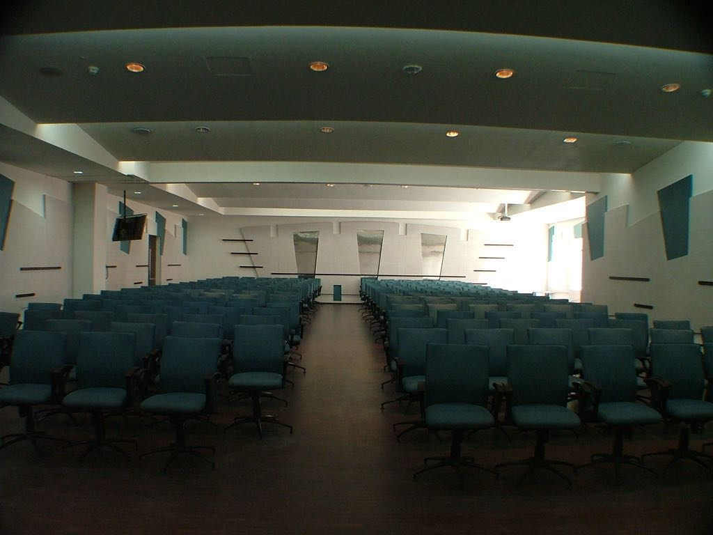 Spacious Auditorium With Blue Chairs by Mohit Kumar Modern | Interior Design Photos & Ideas