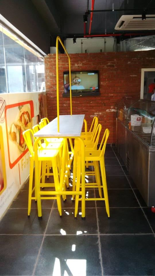Cafeteria With Yellow Chairs and brick wall by Mohit Kumar Modern | Interior Design Photos & Ideas