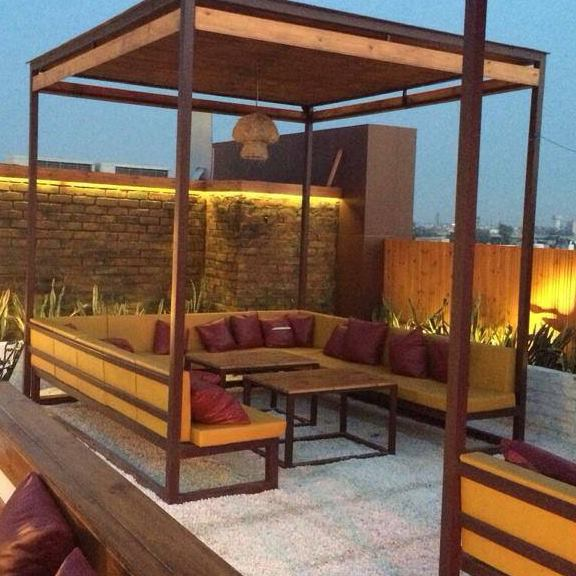 Open Restaurant With U-Shape Sofa by Mohit Kumar Contemporary | Interior Design Photos & Ideas