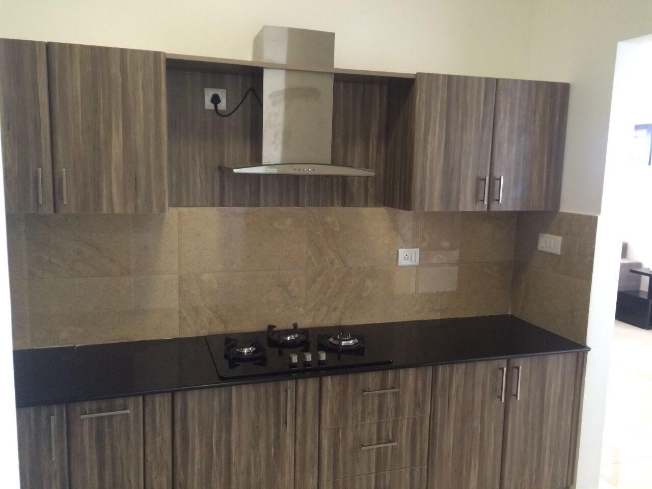 Wood Finish Kitchen by Odd architecture studio  Modular-kitchen Modern | Interior Design Photos & Ideas